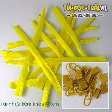 Túi lưới nhựa màu vàng dài 40 cm kèm khóa rút (1 kg)